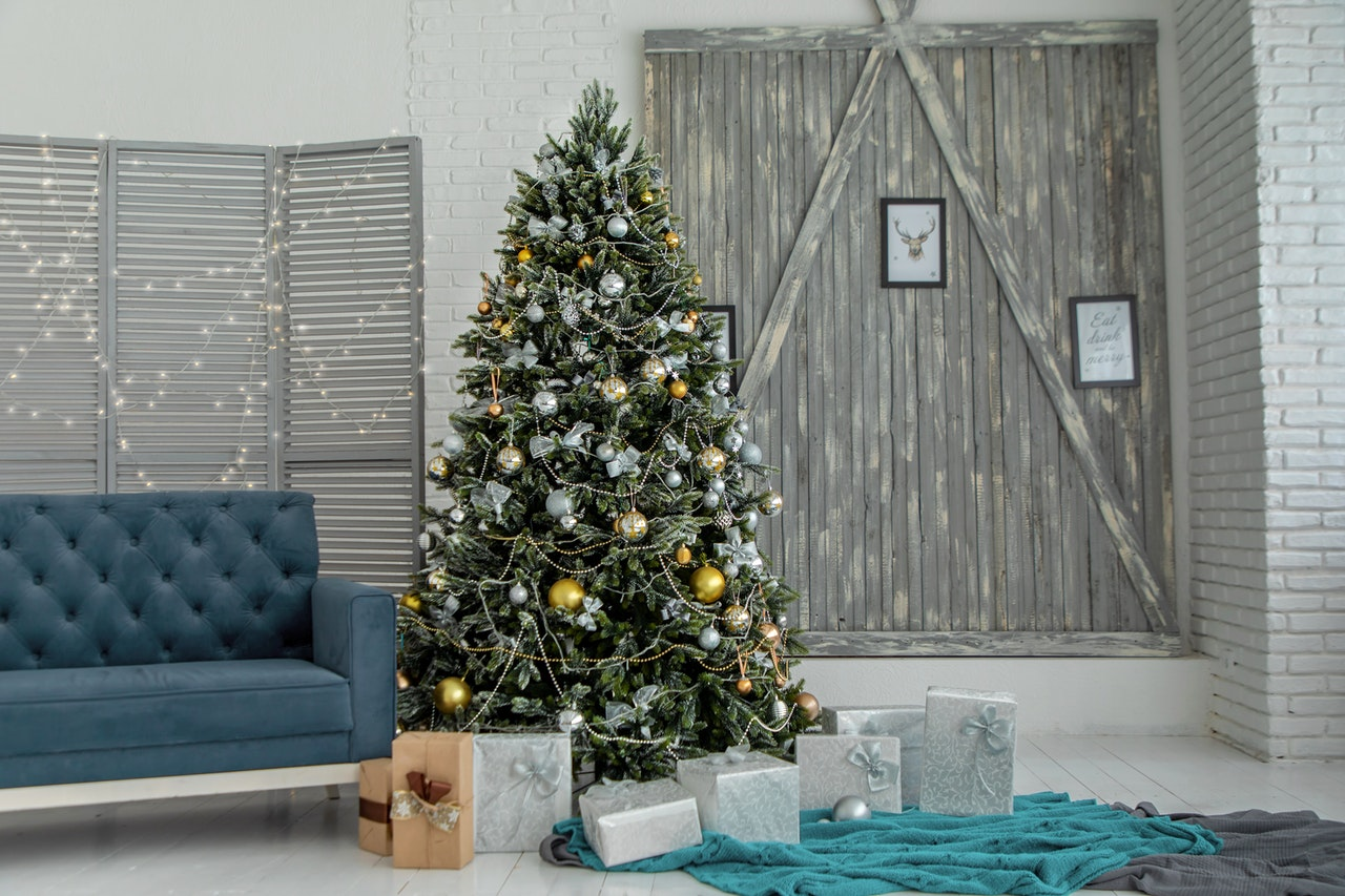 Christmas tree with blue sofa